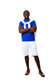 Happy african man standing with arms folded. Full length portrait of a happy african man standing with arms folded over white background Royalty Free Stock Images