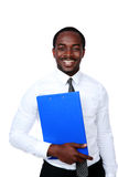 Happy african man standing with blue folder. Isolated on white background royalty free stock photography