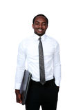 Happy african man standing with laptop Stock Photography
