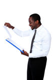 Happy african man standing. And reading document isolated on white background Stock Photo