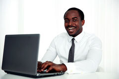Happy african man using laptop Royalty Free Stock Images