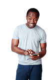 Happy african man using smartphone Royalty Free Stock Photo