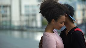 Happy african student hugging girlfriend, college pupils love romantic feeling. Stock footage stock video
