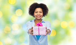Happy african woman with birthday gift box Royalty Free Stock Photos