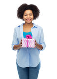 Happy african woman with birthday gift box Stock Photography
