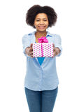 Happy african woman with birthday gift box Stock Images