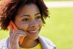Happy african woman calling on smartphone outdoors Stock Photos