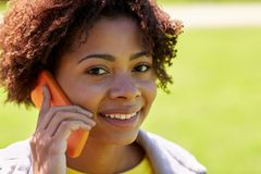 Happy african woman calling on smartphone outdoors Royalty Free Stock Image