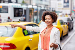 Happy african woman catching taxi Royalty Free Stock Images