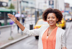 Happy african woman catching taxi Royalty Free Stock Photography