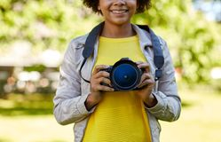 Happy african woman with digital camera in park Royalty Free Stock Image