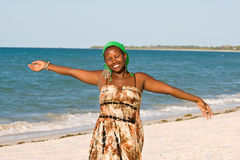 Happy African woman. Enjoying the sun at the beach Stock Photo