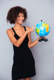 Happy african woman holding globe Royalty Free Stock Photos