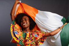 Free Happy African Woman In National Clothes Smiling And Posing With A Flag Ivory Coast, C Te D`Ivoire Isolated Over A Gray Stock Image - 167026151