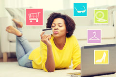 Happy african woman with laptop and credit card Royalty Free Stock Photography