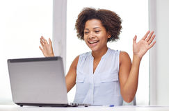 Happy african woman with laptop at office Stock Images