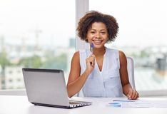 Happy african woman with laptop at office royalty free stock images
