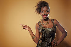 Happy african woman pointing. With her index finger Stock Photography