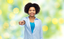 Happy african woman pointing finger to you Royalty Free Stock Image