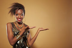Happy african woman presenting Royalty Free Stock Images