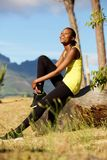 Happy african woman taking break from workout Royalty Free Stock Image