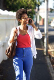 Happy african woman talking on mobile phone Royalty Free Stock Image