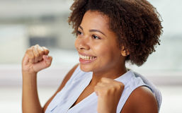 Happy african young woman with raised fists Royalty Free Stock Photos