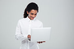 Happy afro american businessman using laptop Stock Images