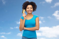 Happy afro american woman with credit card Stock Photos