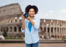 Happy afro american woman with digital camera Stock Photography