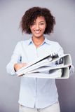 Happy afro american woman giving folders at camera Stock Photos