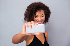 Happy afro american woman making selfie photo Stock Photos