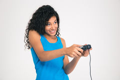 Happy afro american woman playing in video game with joystick Royalty Free Stock Images