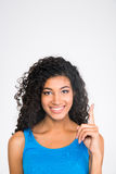 Happy afro american woman pointing finger up Royalty Free Stock Image