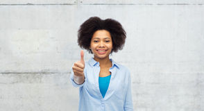 Happy afro american woman showing thumbs up Stock Images