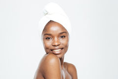 Happy afro american woman with towel on head Royalty Free Stock Image