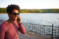 Happy afro american young man talking on phone Stock Photo