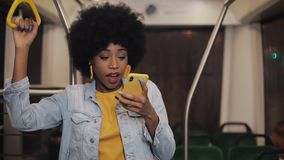 Happy afro businesswoman cheering celebrating looking at smartphone. Young urban professional successful business woman stock video footage
