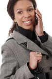Happy afro businesswoman on mobile Stock Images