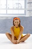 Happy afro dancer girl stretching on floor Royalty Free Stock Images