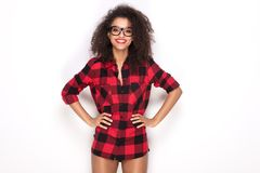 Happy afro girl in red checkered shirt. Happy beautiful african american girl with amazing toothy smile posing in checkered shirt. White background Stock Photography