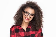 Happy afro girl in red checkered shirt. Happy beautiful african american girl posing in checkered shirt. White background Stock Photo