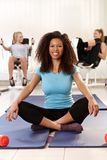 Happy afro girl relaxing at the gym Royalty Free Stock Photography
