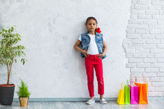 Happy afro girl with shopping bags Stock Image