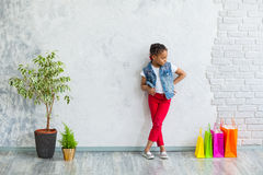 Happy afro girl with shopping bags Royalty Free Stock Image
