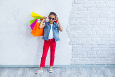 Happy afro girl with shopping bags Royalty Free Stock Photography