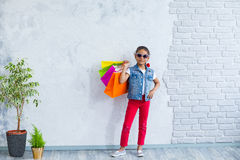 Happy afro girl with shopping bags Stock Photography