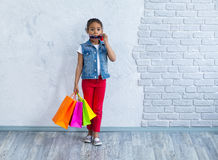 Happy afro girl with shopping bags Royalty Free Stock Photo