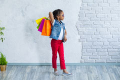 Happy afro girl with shopping bags Stock Photo