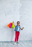 Happy afro girl with shopping bags Stock Photos